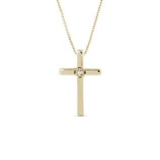 Diamond cross charm for children in 14kt yellow gold