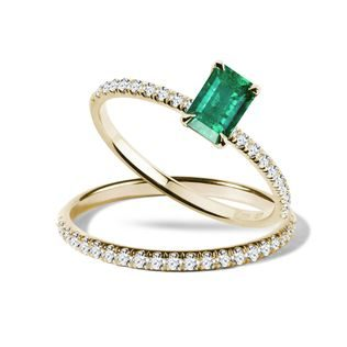 Emerald and diamond engagement set in gold