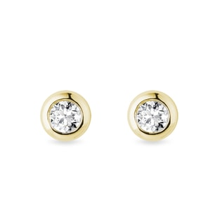 3.55 mm diamond bezel earrings in yellow gold