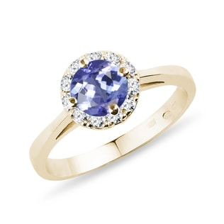 Gold halo ring with tanzanite and diamonds