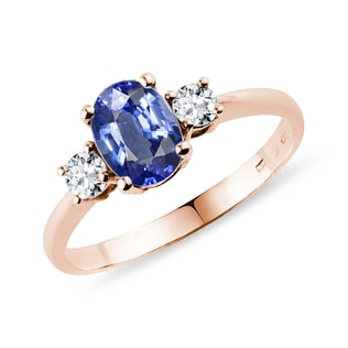 Blue sapphire and diamond band engagement ring in rose gold