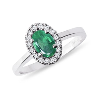 Emerald and diamond halo ring in white gold
