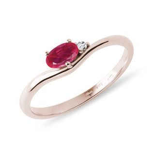 Oval ruby ring with diamonds in gold