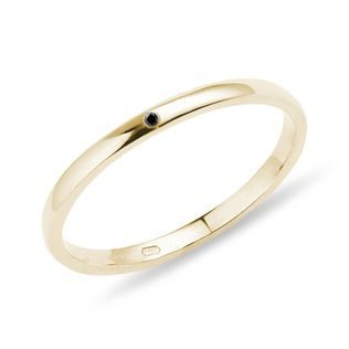 Black diamond ring in yellow gold