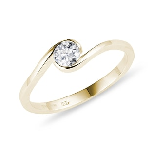 Asymmetric gold ring with a diamond
