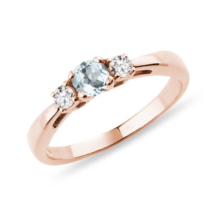 Bague en or rose avec diamants et aigue-marine