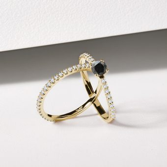 gold rings set with small diamonds with a central black diamond - KLENOTA