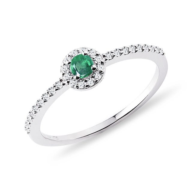 Diamond ring with an emerald