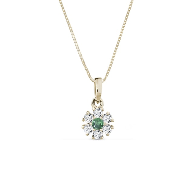 Necklace in yellow gold with diamonds and an emerald