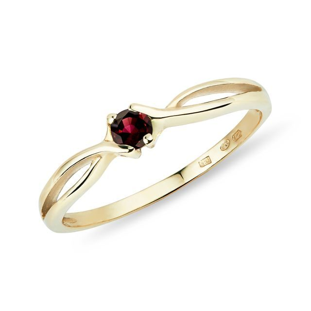 Interesting garnet ring in gold