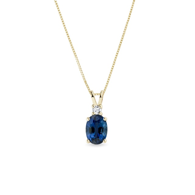 Pendant with sapphire and diamonds in yellow gold