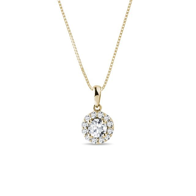 Diamond halo necklace in yellow gold