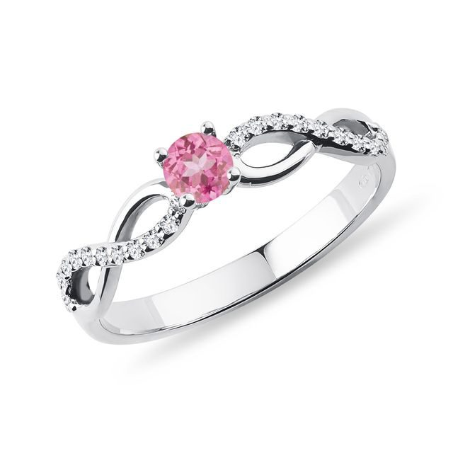 Pink sapphire and diamond engagement ring in white gold