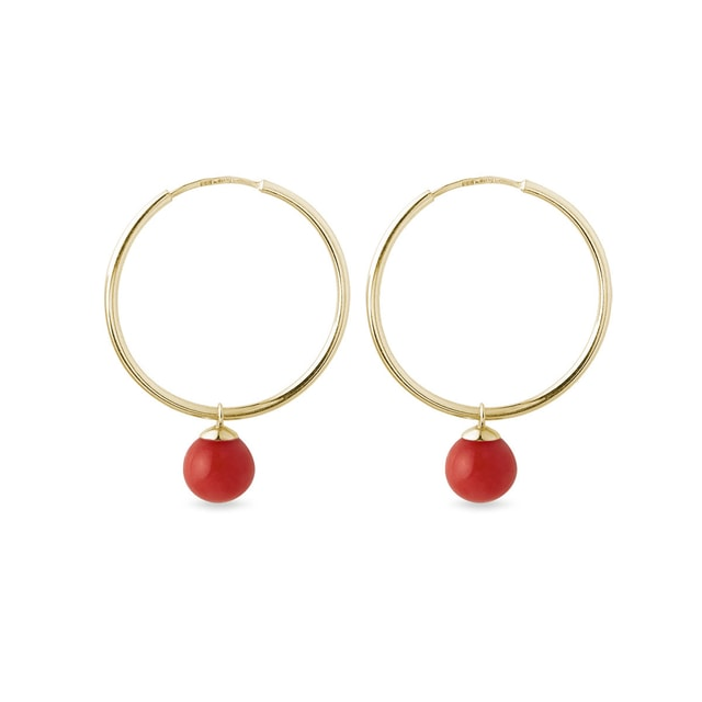 Gold hoop earrings with round coral pendants