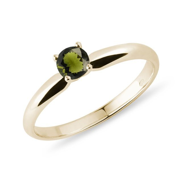 Round moldavite ring in yellow gold