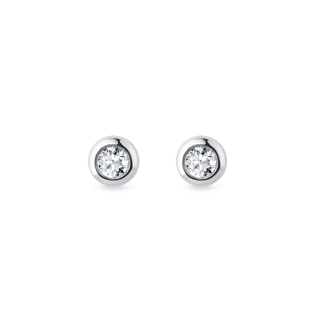 Diamond bezel earrings in white gold