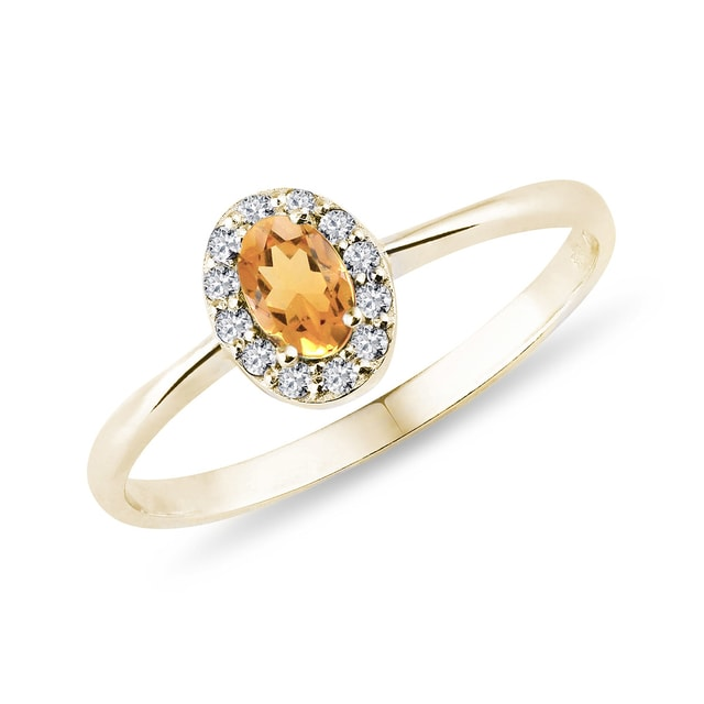 Citrine and diamond halo ring in yellow gold
