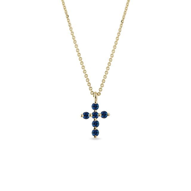 Sapphire cross ring in gold