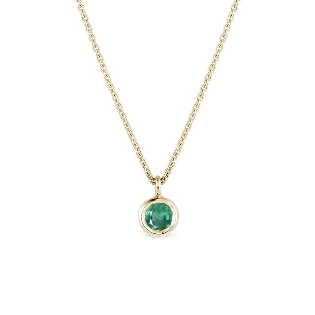 Bezel emerald necklace in yellow gold