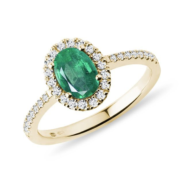 Oval emerald and diamond ring in gold