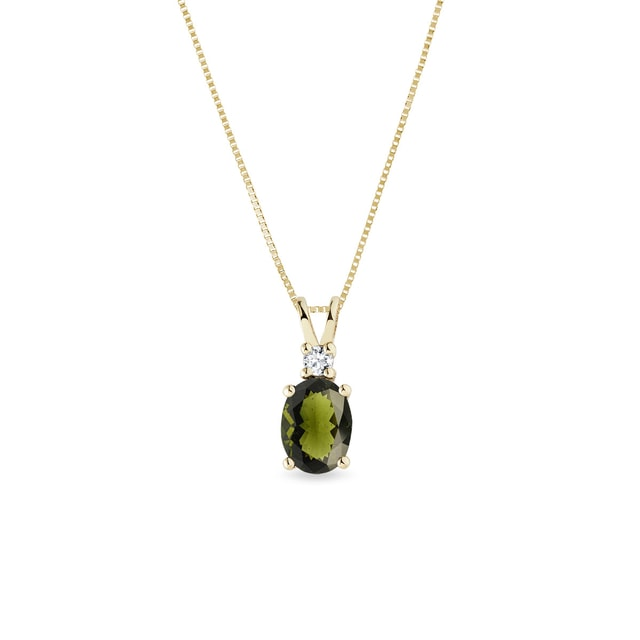 Diamond and moldavite pendant in yellow gold