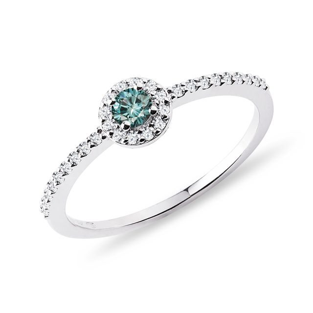 Engagement ring with a blue diamond
