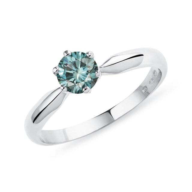 Gold engagement ring with blue diamond