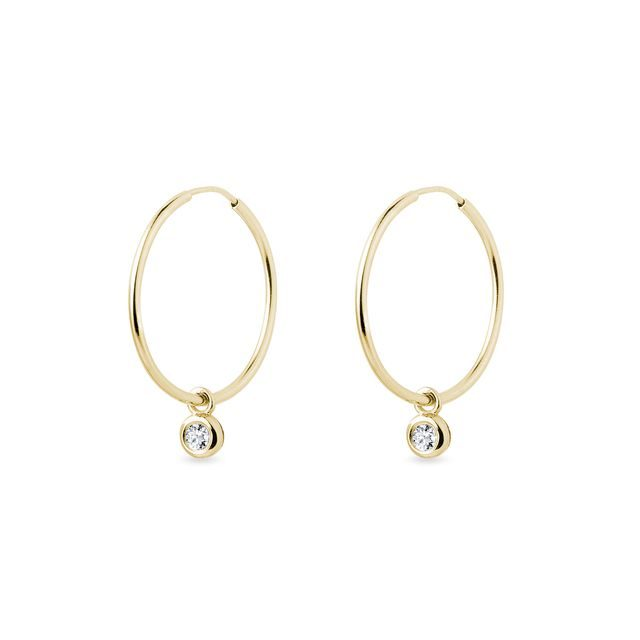 Bezel set diamond hoop earrings in gold