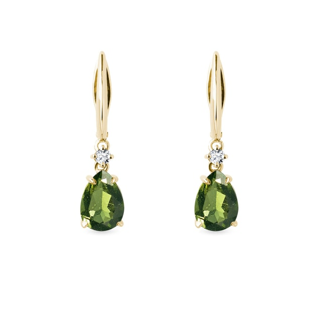 Diamond and moldavite earrings in yellow gold