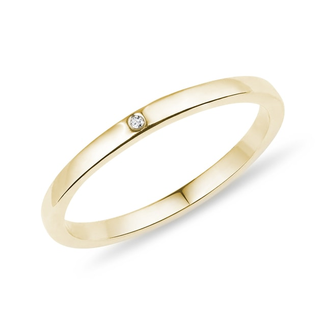 Gold wedding ring with a diamond