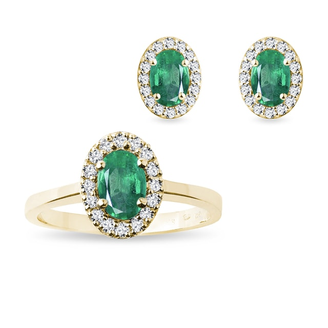 Emerald and diamond halo earring and ring set in yellow gold