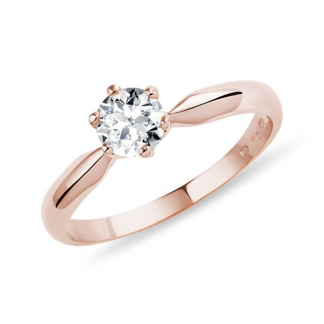 Gold engagement ring with a diamond