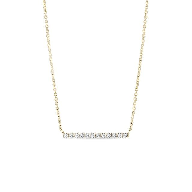 Gold bar necklace with a diamond