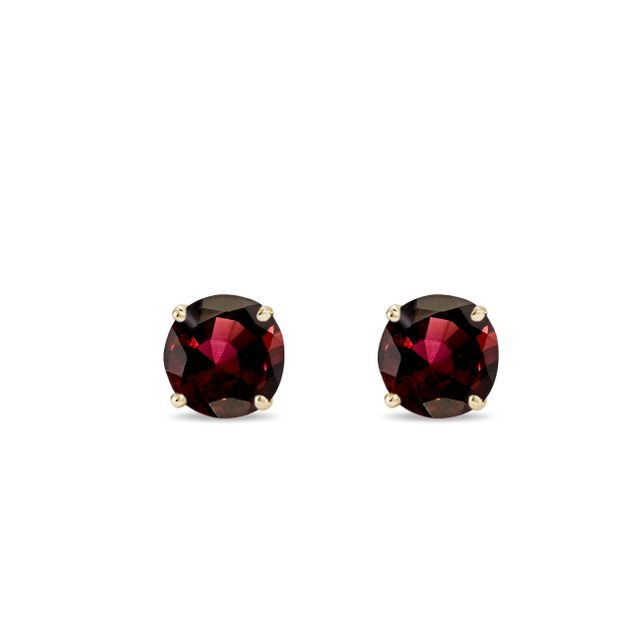Round garnet stud earrings in gold