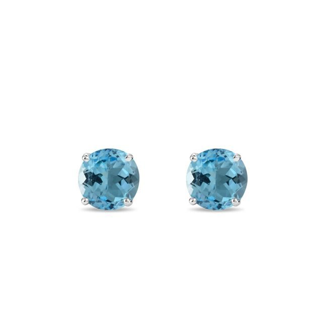Topaz stud earrings in white gold