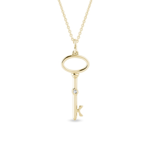 Diamond key pendant in gold