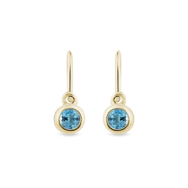 Baby blue topaz earrings in 14kt gold