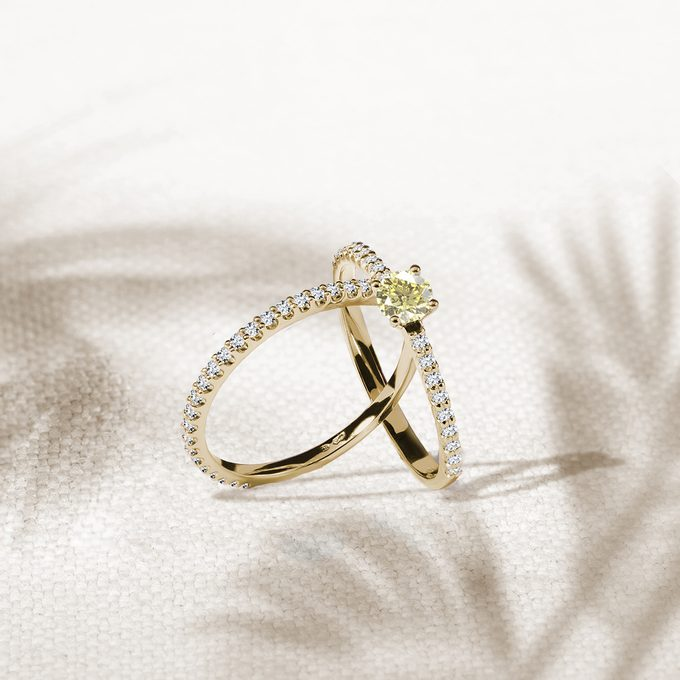 gold eternity rings with central yellow diamond in yellow gold - KLENOTA