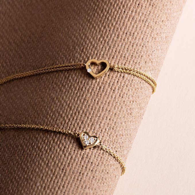 Yellow gold bracelet with heart and diamonds - KLENOTA