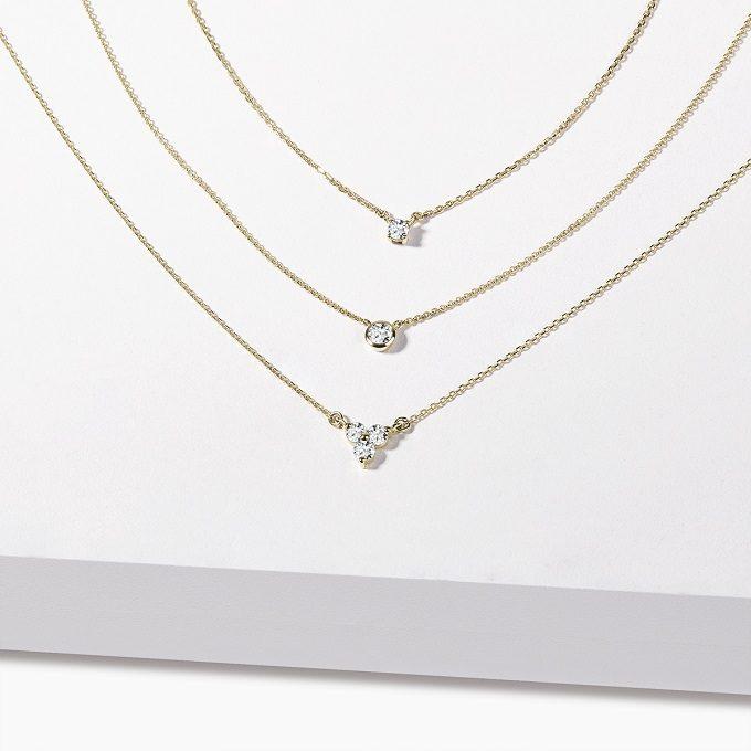 Złote naszyjniki z diamentową ramką - KLENOTA