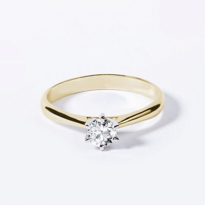 Solitaire engagement ring with diamond in white and yellow gold - KLENOTA