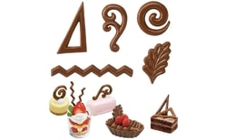 Chocolate moulds on a sheet filigrees