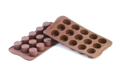 Chocolate moulds on a sheet - Praline
