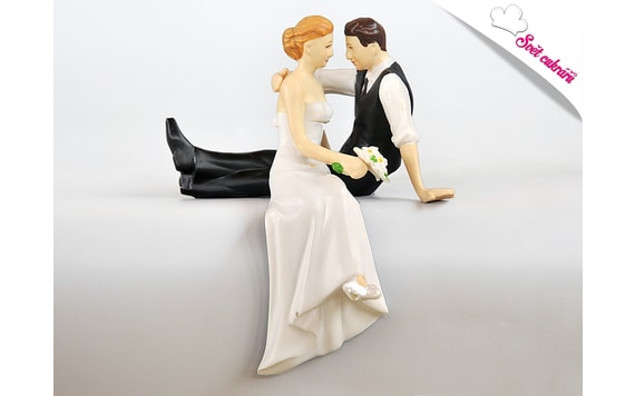 WEDDING CAKE TOPPER - SITTING NEWLYWEDS ON A CAKE EDGE