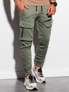 zelené tepláky s modernými vreckami na zips