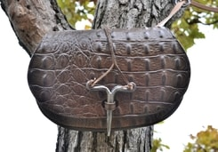 DRAGON SKIN, leather bag with forged needle