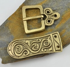 DARK AGE, belt buckle and strap end, brass colour