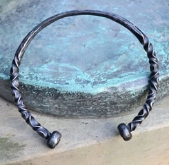 FORGED TORC WITH BALL TERMINALS