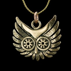 OWL HEAD, pendant, bronze