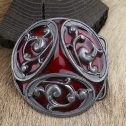 RED TRISKELION, belt buckle